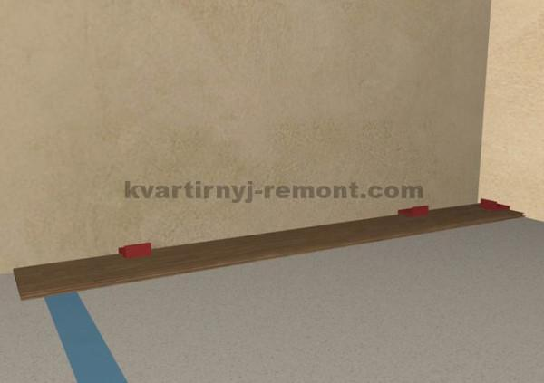 Фото 2 шага укладки досок ламината